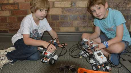Alexander James, 7, (left) with Laurie Dougherty, 9 at the CoderDojo Toowoomba classes run through Canvas Coworking.