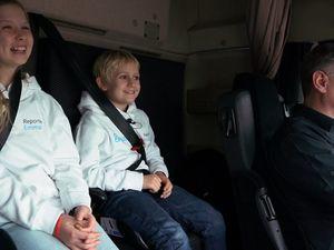 Look mum no hands! Kids get first ride in autonomous truck