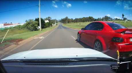 The impatient Commodore driver overtakes the learner.