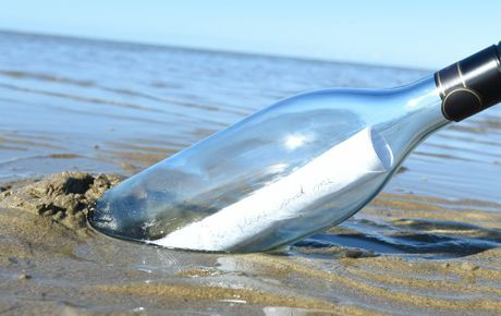 Message in a bottle - John Toonen dropped a bottle with a note into the ocean off South America and it washed up on an island off Tasmania. Photo: Alistair Brightman / Fraser Coast Chronicle