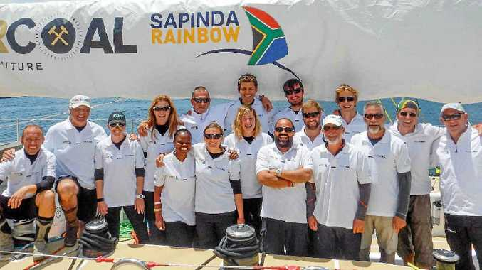 BACK HOME: Mackay's Nicolette Horak, fourth from the right, on board Ichorcoal, took part in the Clipper Round the World Yacht Race, finishing in Airlie Beach.