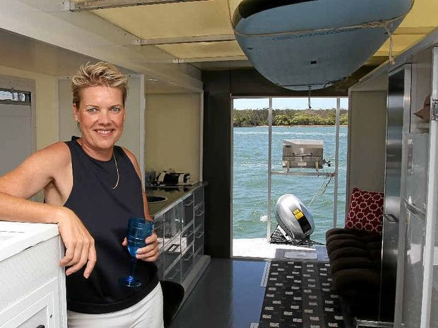 MULTI-PURPOSE: Claudia Moffat in her caravan boat which she has designed and built.