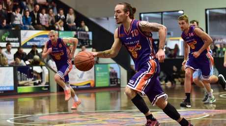 BASKETBALL: Suncoast Clippers Vs Northside Wizards, Maroochydore Basketball Stadium, Buderim. June 6, 2015. Josh Walters, 10, takes the ball up.