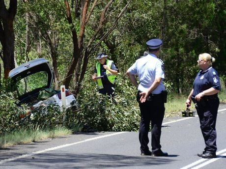 Police investigate a fatal car accident on the Gatton-Esk Road at Mt Hallen. Photo: David Nielsen / The Queensland Times