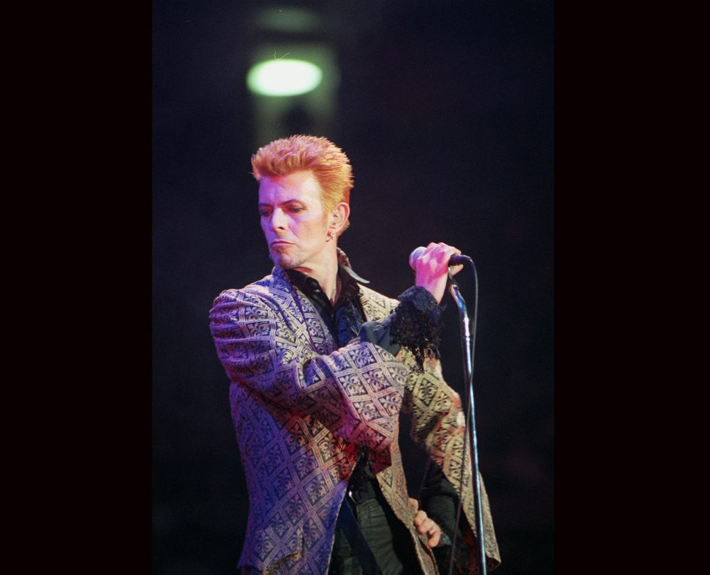 FILE - In this Jan. 9, 1997, file photo, David Bowie performs during a concert celebrating his 50th birthday, at Madison Square Garden in New York. Bowie, the innovative and iconic singer whose illustrious career lasted five decades, died Monday, Jan. 11, 2016, after battling cancer for 18 months. He was 69. (AP Photo/Ron Frehm, File)