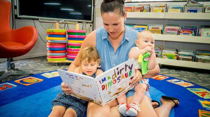 Moranbah mum Tianna Graham reading I'm a dirty dinosaur to her children Eva and Korbin - it's never too early to talk, read and share stories. Photo: Contributed