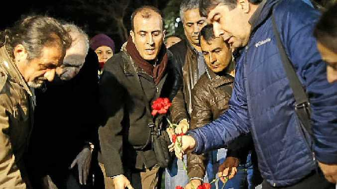 FLOWER POWER: Turkish citizens pay their respects.