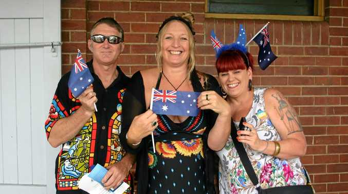 TRUE BLUE DAY: Susan Osborne (centre) of Kyogle celebrates becoming an Australian citizen with her partner Steve McQueen and friend Josie Donnelly.