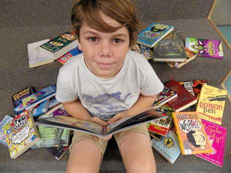 BOOK BONANZA: Christian Macqueen, 9, at Casino Library to promote the Summer Reading Challenge.