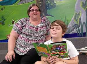 Casino Library Technician Taryn Kelly with Christian Macqueen promoting the Summer Reading Challeneg for children. They have to read 10 books by the end of January 2016.Photo Susanna Freymark / Richmond River Express Examiner