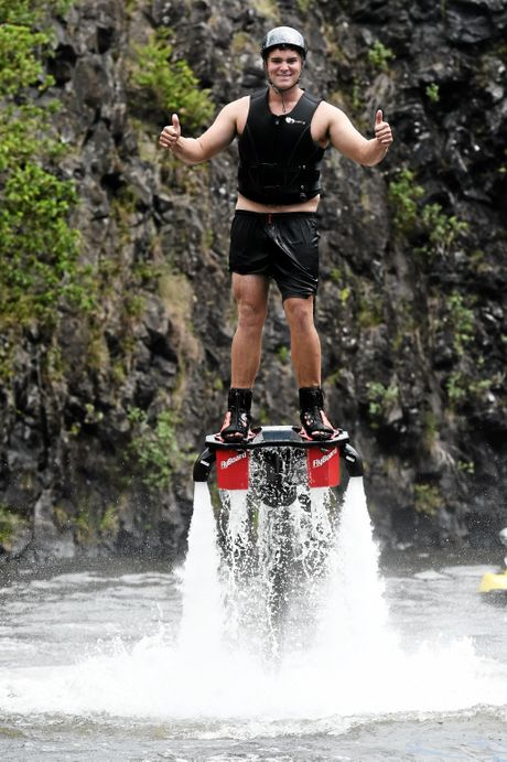 UP, UP AND AWAY! Flyboard Byron Bay owner Liam Alrich, pictured with the tools needed for flight and, at right, in action.