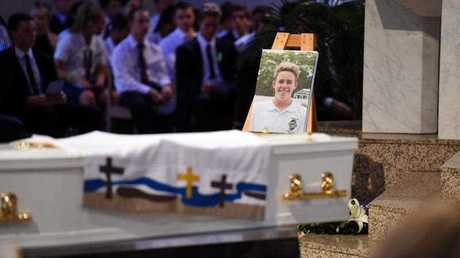 A portrait of 18 year-old one-punch victim Cole Miller is placed near the coffin during his funeral service in Brisbane, Wednesday, Jan. 13, 2016. Cole died in hospital on January 4 from massive brain trauma a day after allegedly being hit in Brisbane's Fortitude Valley.