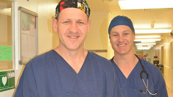Dr David Morrissey heads into surgery at St Vincent's Private Hospital today. David is pictured with anaesthetist Dr Andrew Wilke who also started with the hospital today.