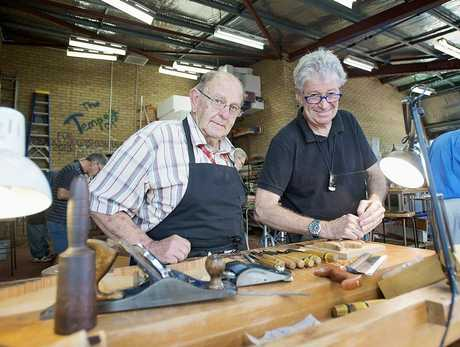 McGregor Summer School masterclass student Brian 'Shiny' Smith (left) with wood carving tutor Laurens Otto.