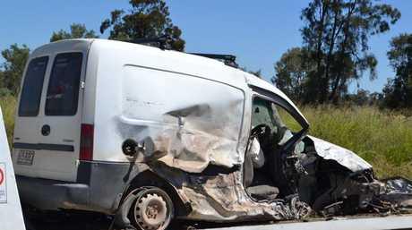 Ivan Edney's van is removed from the crash scene.