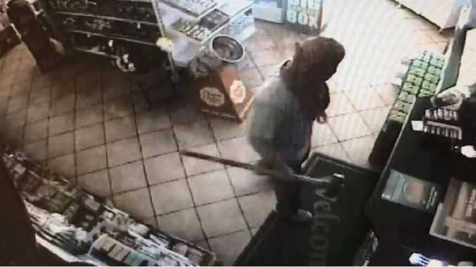 BLUNT FORCE: A thief wields a sledgehammer during a break-in at BP Tanawha.