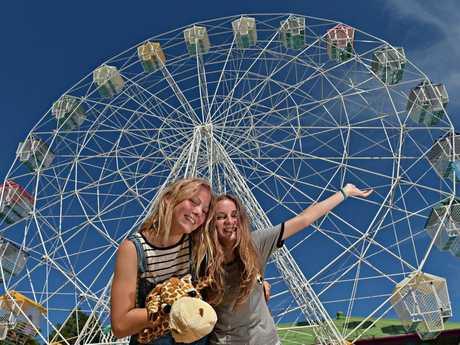 Izzy Denby,14, and Isabella Palmer, 14, eye off the refurbished Ferris wheel at Aussie World.