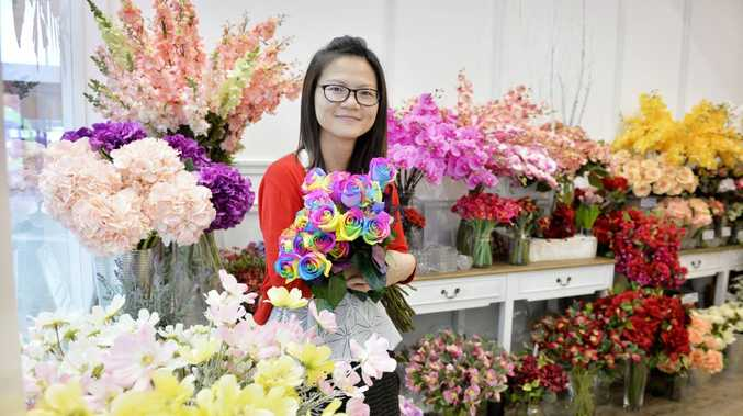 SMELL OF SUCCESS: Owner of Sweet Moments Florist, Alice Sui, at Orion Springfield. She moved from Hong Kong to Australia so she could achieve her dream.