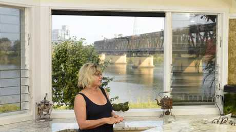 Julie Whetton of Grafton in her kitchen with views of the Grafton bridge. The house is in the planned path of the second bridge crossing the Clarence River.