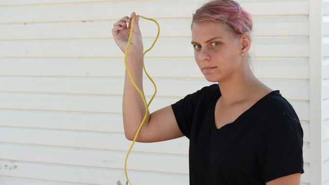Talitha Beatson holds a cord found with her dead cat. Photo Allan Reinikka / The Morning Bulletin