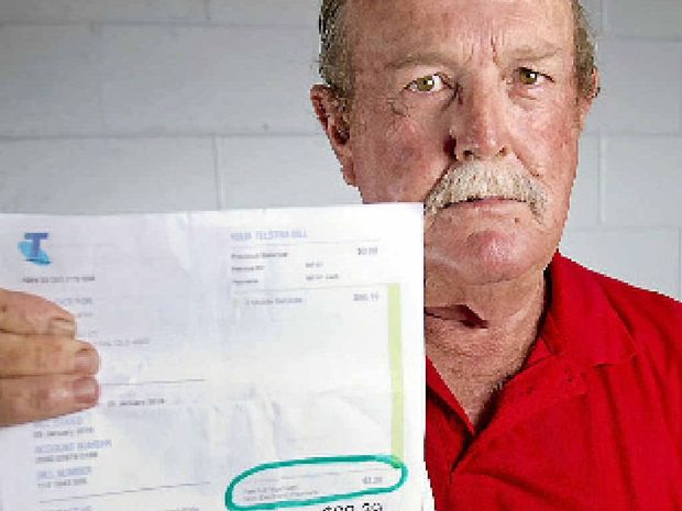 FEE FIGHTER: Kerry Smith doesn't understand why he has to pay $3.20 to pay his monthly Telstra bill in the Telstra store.