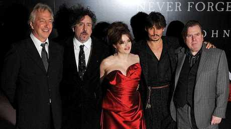 Actor Alan Rickman, Director Tim Burton, Actress Helena Bonham Carter, Actor Johnny Depp and Actor Timothy Spall pose for photographers at the premiere of Sweeney Todd: The Demon Barber of Fleet Street, in London.