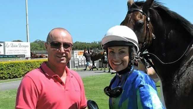 Trainer Brett Dodson and jockey Priscilla Schmidt at Coffs Harbour's Pink Silks meeting after her second last ride.