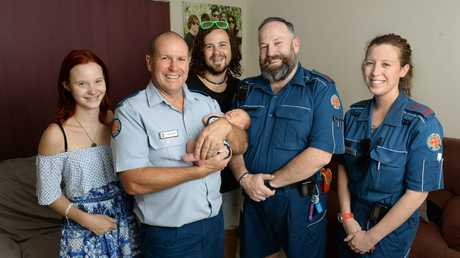 Selene Garton and Brendan Winter with emergency medical dispatcher Terry Hands, their son Izaya, and paramedics Damian Roche and Jennifer Lake who attended after the birth.