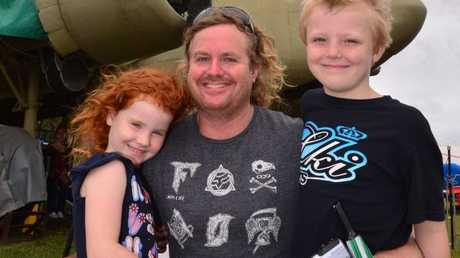 Abe (centre), Amelie and Eli Caldwell enjoy the Aero Engine Run Day at Queensland Air Museum.
