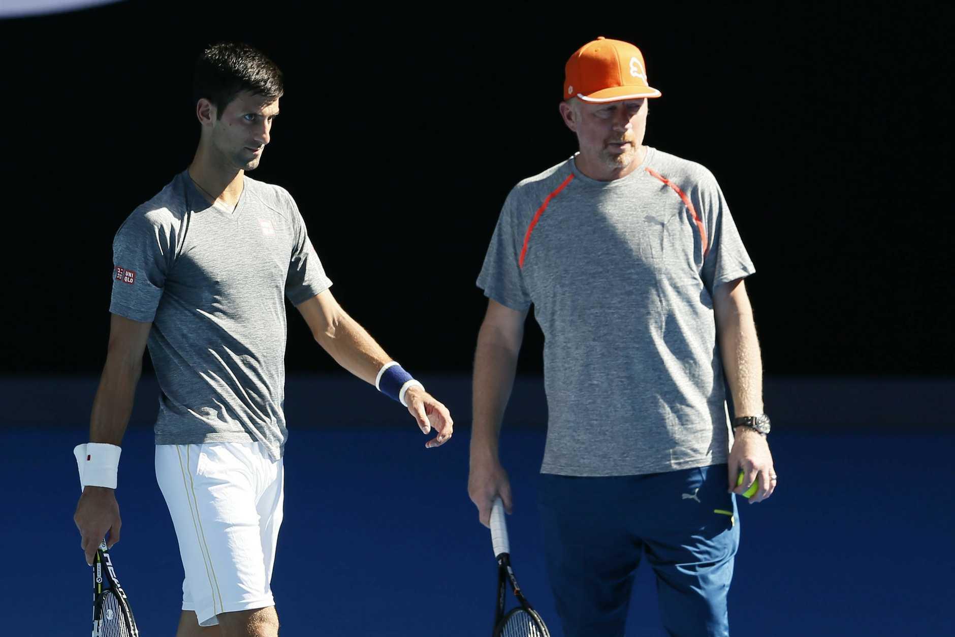 Novak Djokovic practices with coach Boris Becker yesterday. Photo: AAP Image