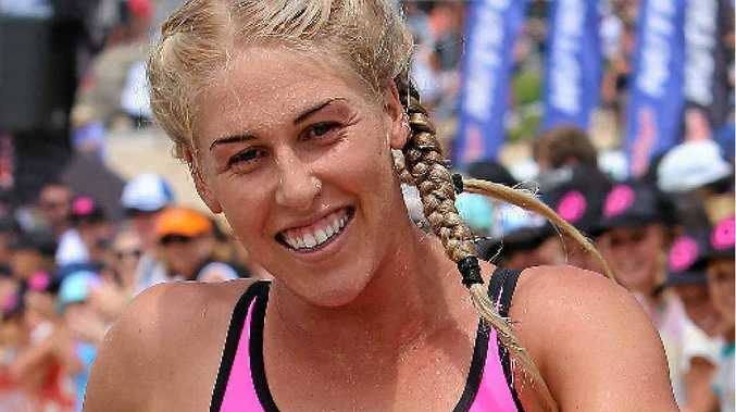 WINNER: Kirsty Higgison takes out round five of the Nutri-Grain Ironwoman Series at North Cronulla Beach yesterday.