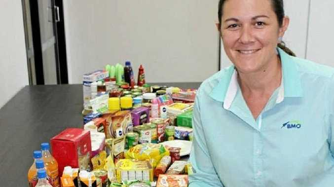 AUSSIES HELPING AUSSIES: Chelsea Wyatt packs food to help Australian farmers who are doing it tough.