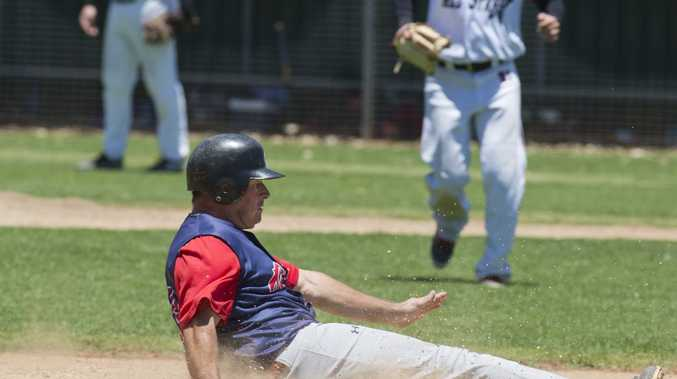 SAFE SLIDE: Toowoomba Rangers coach Tony Tarca slides into third base at Commonwealth Oval. Photo Kevin Farmer / The Chronicle