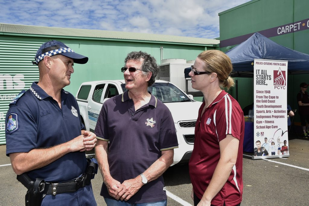 PLATE SECURITY: Keeping your number plate securely on your car is just a matter of a change of screw. Assisting people are from left; Sergeant Scott McGrath, with Jim Smith and Senior Constable Leigh James. Photo Bev Lacey / The Chronicle
