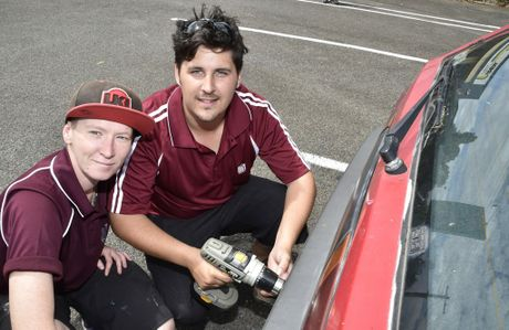 Keeping your number plate securely on your car is just a matter of a change of screw. Fixing new screws for drivers are volunteers, Tylah Schmidt (left) and Malcolm Fisher.