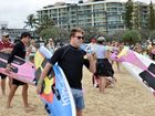Paddle out at Mooloolaba Beach for the remembrance of Cole Miller. His brother Mitchelle Miller (black rashie, sun glasses).