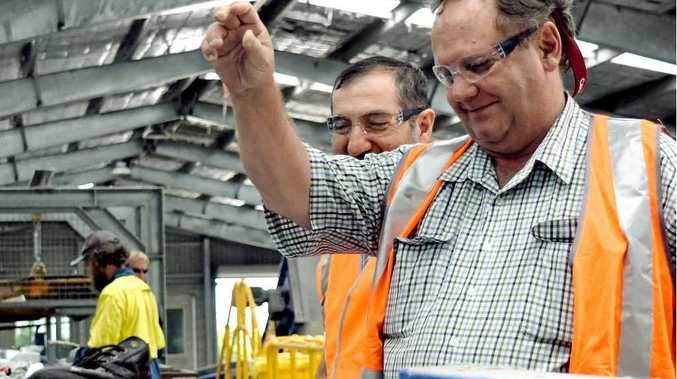 TOUR: Mackay Regional Councillor Laurence Bonaventure (left) guides Central Highlands Regional Council Mayor Peter Maguire through Mackay's material recovery facility.