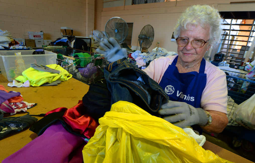 """PLENTY OF DONATIONS: Vinnies' volunteer Daphne Sturgess carrying out a """"first sort"""" where usable and unusable donations are separated."""