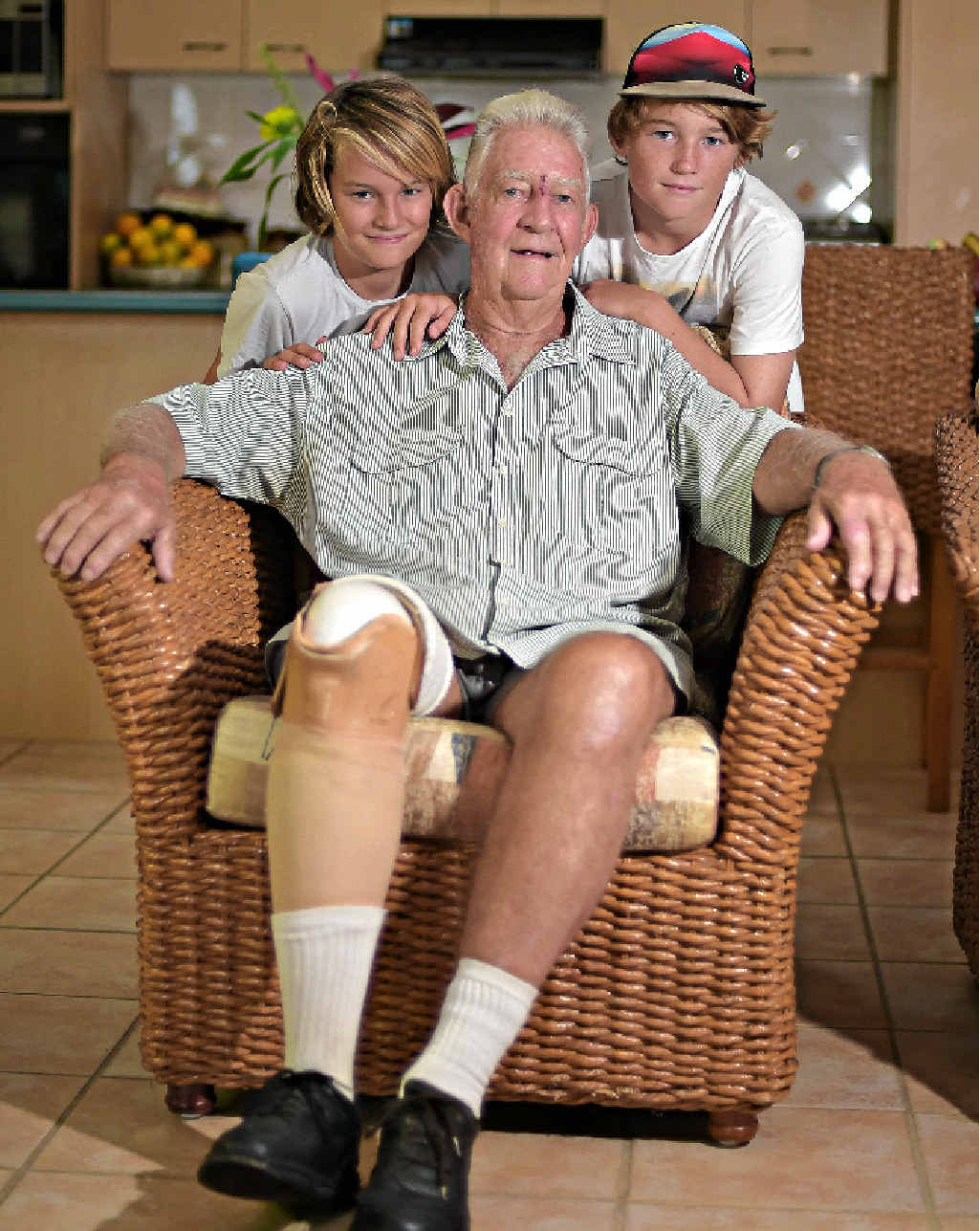 PEEVED: Geoff Loe is upset his hand-made walking stick was stolen. Geoff is pictured with his grandsons Tristan (right) and Bailey Eva.