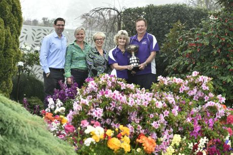 GARDEN CHAMPIONS: Bob and Val Ford (right) in their Burke St garden after being announced the Chronicle Garden Competition grand champions for 2015 with representatives from the council, Heritage Bank and The Chronicle.