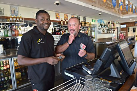 New research shows Australian employees struggle to add and spell. Sunshine Coast hospitality stalwart Ashley Robinson and employee Victor Bado till adding up costs of drinks.