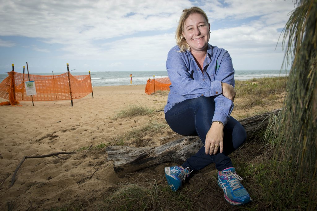 Jodi Jones from Conservation Volunteers Australia watches of the turtle eggs at the Tannum Sands main beach. Photo Paul Braven / The Observer