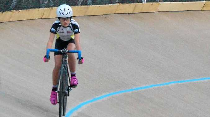 Hollie Andrews won a silver and bronze at the state junior track titles. INSET: Central Queensland's Anna Meares is Hollie Andews' cycling hero.