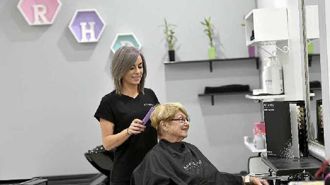 HAIR CARE: RHair Design owner and operator Kristie Sharpley styles customer Pattie Dietz's hair.