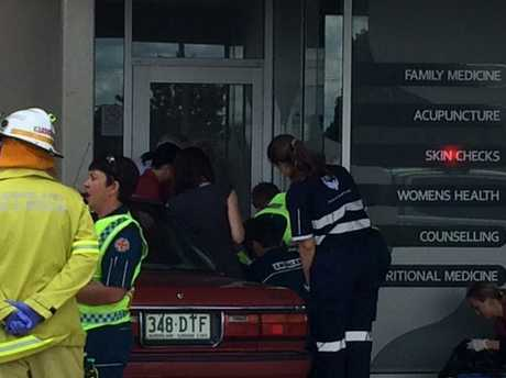 The Range Medical Centre staff and emergency services personnel treat a woman involved in a crash in the car park of High Street Plaza.
