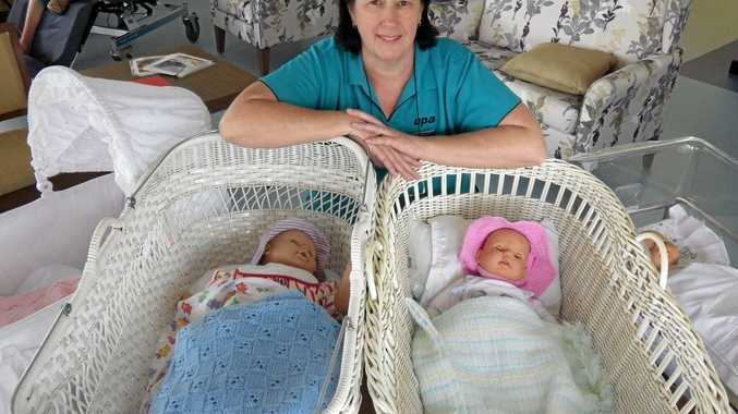 REDUCING ANXIETY: Richmond Lodge activities officer Helen Carbery advocates doll therapy for dementia patients.