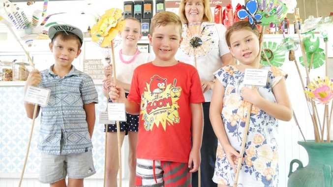 ART: Jaylin Reed (8), Abby Smith (11), Ty Wilson (6), Botanic Gardens Visitor Services Officer Maya Harrison and Charlotte Redfern (6) at the exhibition launch. Photo Contributed