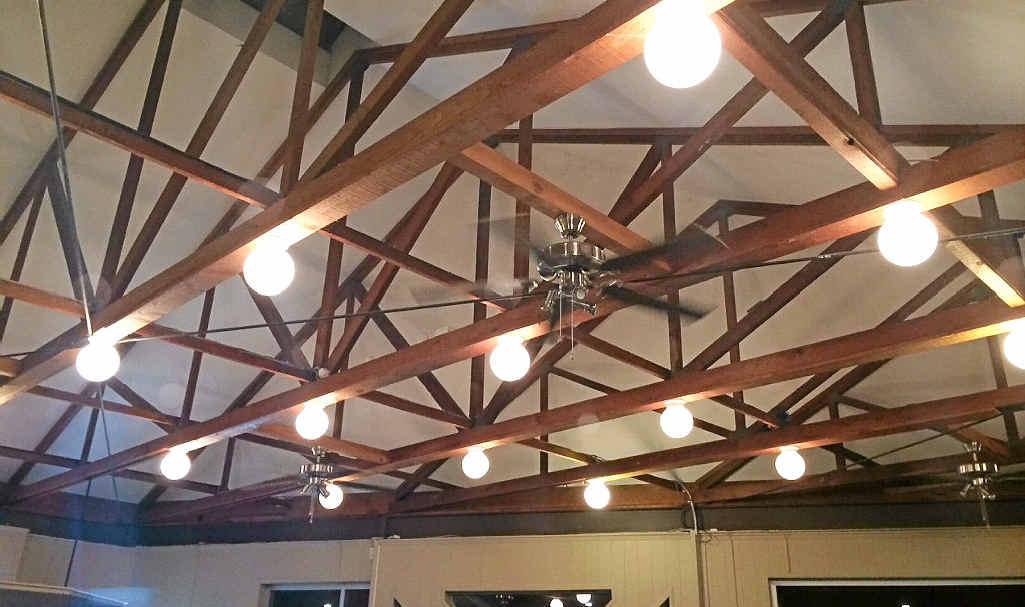 Exposed decorative truss ceiling.
