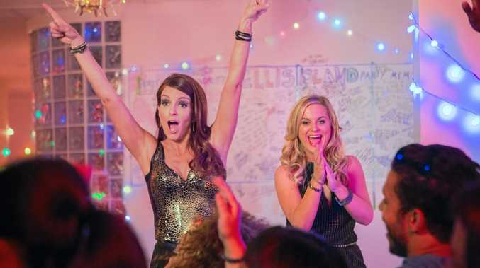 PARTY ON: Tina Fey and Amy Poehler in a scene from the movie Sisters.