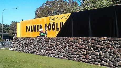 Graffiti being cleaned off the front of the Palmer Coolum Resort.